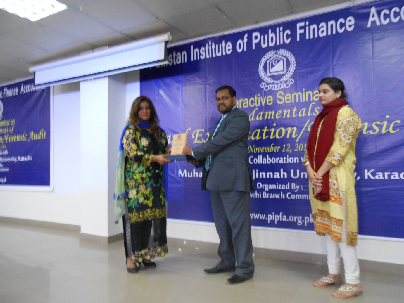 Mr. Tariq Hussain presenting shield to Dr. Sana Wiqar, Session Speaker