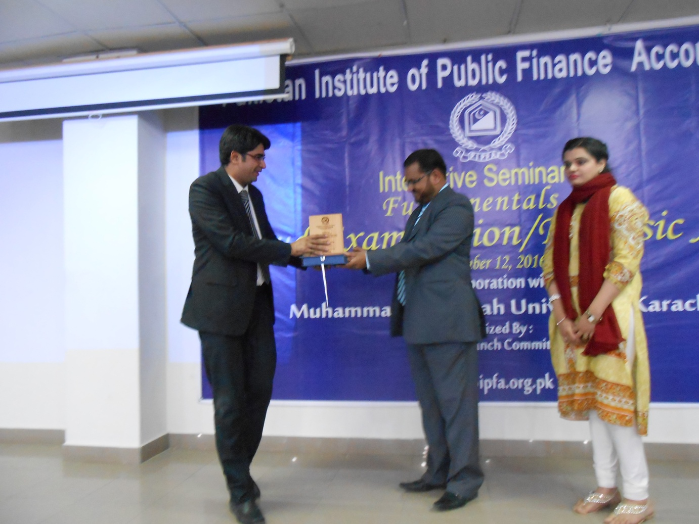 Mr. Tariq Hussain presenting shield to Dr. Shujat Mubarak