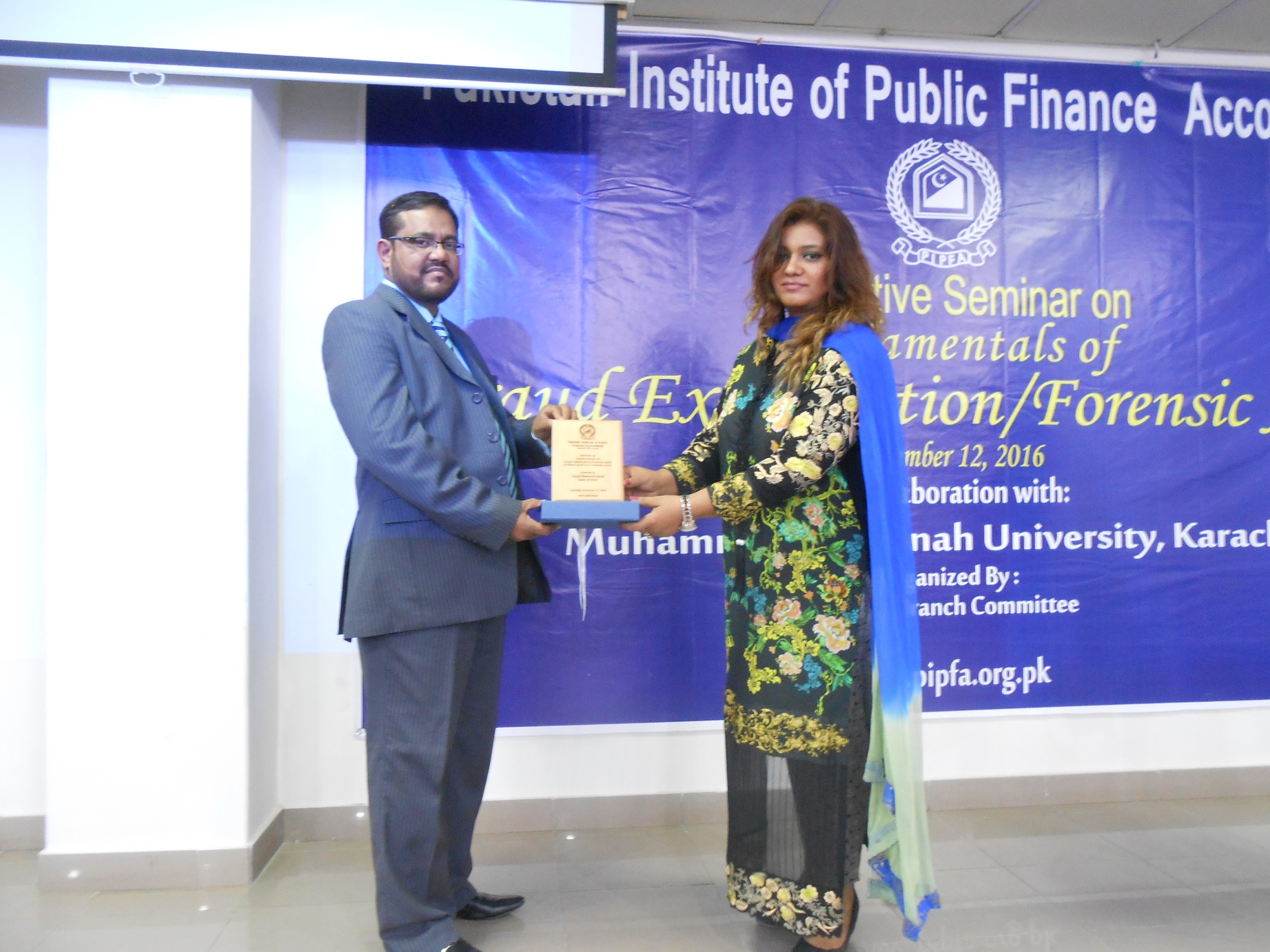 Dr. Sana Wiqar, Convener KBC Presenting shield to Mr. Tariq Hussain Chairman Session