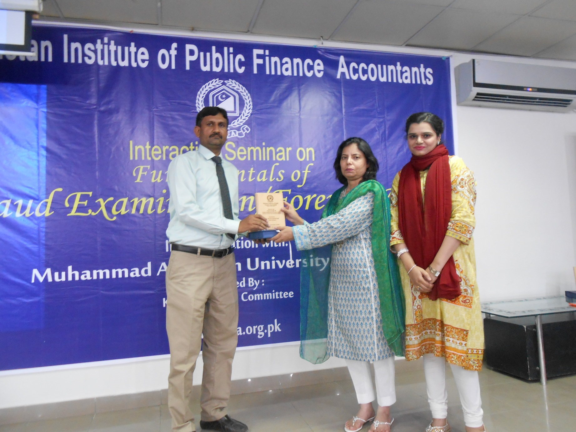 Ms. Rana Nazir Fatima, Executive Director presenting shield to Guest of Honor Mr. Ghulam Muhammad, D